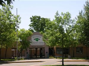 The front entrance of the community center surrounded by trees